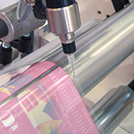Dispense adhesive for packaging